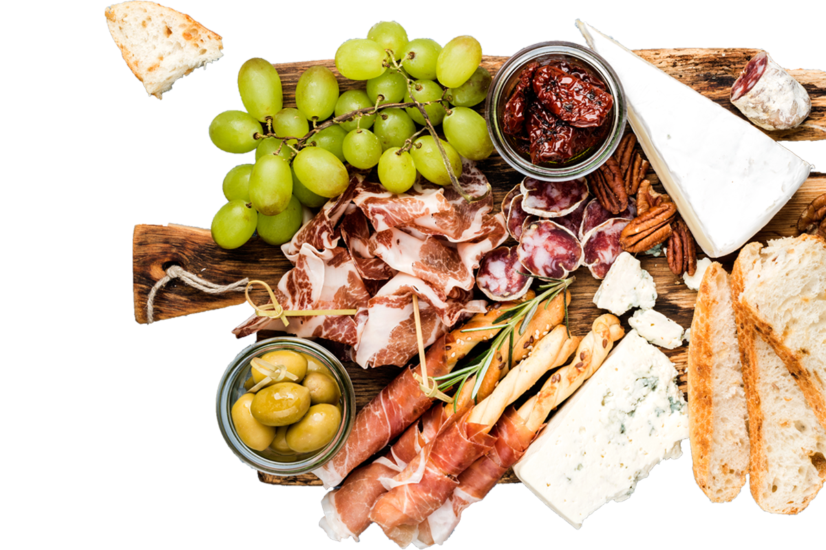 Food variety of cheese, meat, and fruits